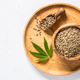 Cannabis seeds at white table top view - PhotoDune Item for Sale
