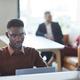 African-American Man Using Laptop in Coworking - PhotoDune Item for Sale
