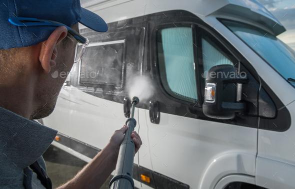 Men Washing RV Camper Van Using Pressure Washer - Stock Photo - Images
