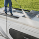 RV Industry Worker Cleaning Camper Van Roof and Motorhome Solar Panels - PhotoDune Item for Sale