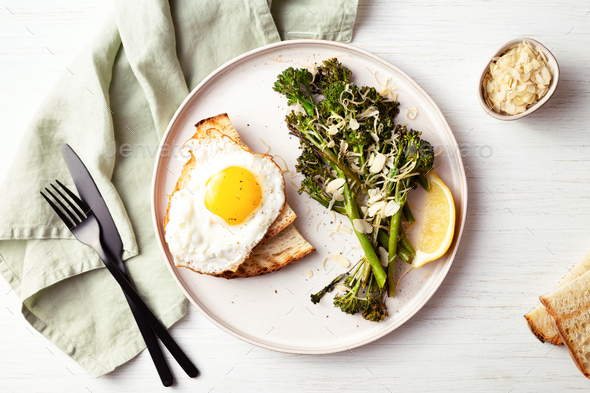 Healthy Breakfast with Broccolini, Fried Egg and Tost. - Stock Photo - Images