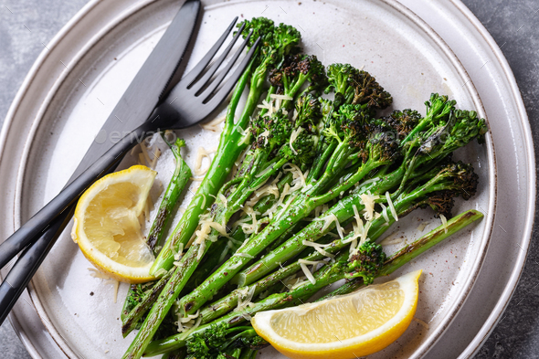Roasted Broccolini with Lemon on the Plate. - Stock Photo - Images