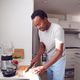 Man Wearing Pyjamas Standing In Kitchen Chopping Fruit For Fresh Smoothie - PhotoDune Item for Sale