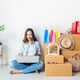 Young asian woman with colorful shopping bag and stack of cardboard boxes at home - PhotoDune Item for Sale