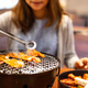 Young asian eating korean barbecue yakiniku in restaurant - PhotoDune Item for Sale