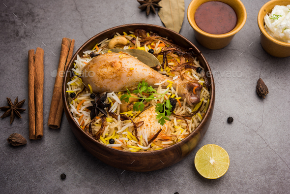 Chicken Biryani with yogurt dip - Popular Indian / pakistani Non vegetarian food - Stock Photo - Images