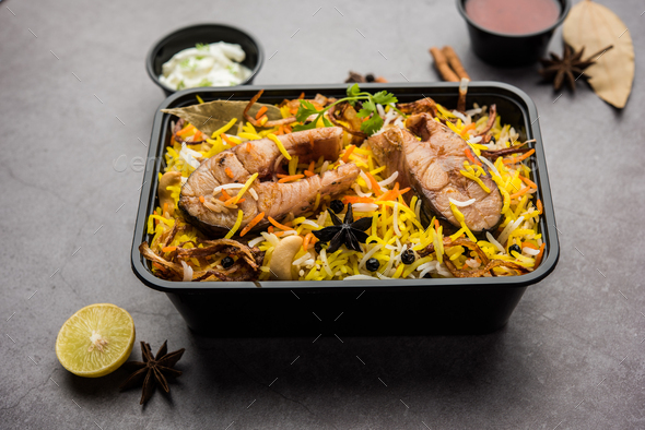 Online Food Delivery Fish Pulao Or Biryani Packed In Plastic Box Stock Photo By Stockimagefactory