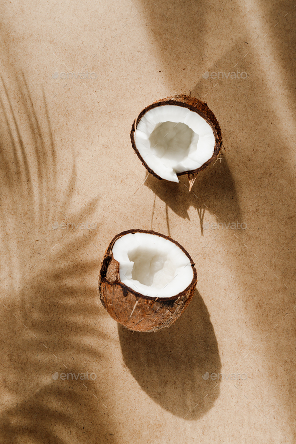Summer abstract creative composition with coconut and shadow of palm leaf on kraft paper. - Stock Photo - Images