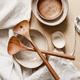 Modern minimalist ceramics set with a linen cloth over kraft paper background. - PhotoDune Item for Sale