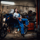 Hot brunette woman in blue overalls posing for a camera while leanign on sportbike - PhotoDune Item for Sale