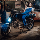 Female mechanic relaxing smoking a cigarette while lying on custom bobber in garage or workshop - PhotoDune Item for Sale