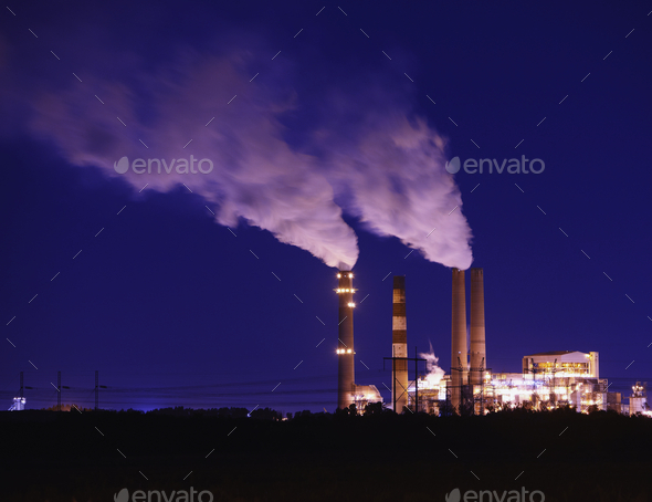 Smokestacks Billowing Smoke  At Night - Stock Photo - Images