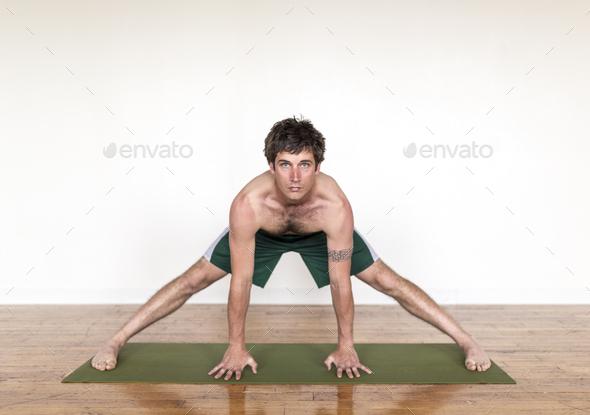 Man practicing yoga in studio - Stock Photo - Images