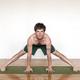 Man practicing yoga in studio - PhotoDune Item for Sale
