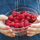 Young child holding a bowl of fresh raspberries - PhotoDune Item for Sale