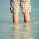 man standing in the sea water - PhotoDune Item for Sale
