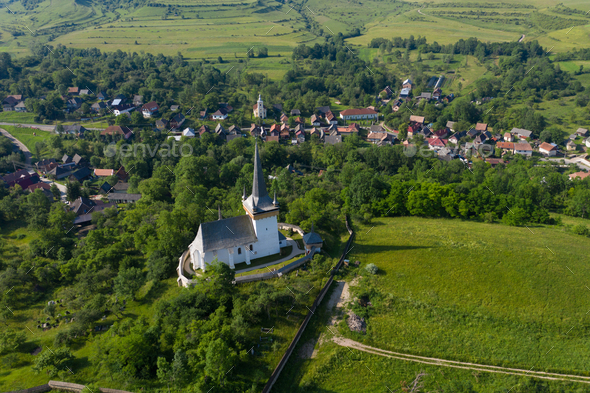 Aerial view of a reformed church in Transylvania - Stock Photo - Images