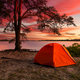 Orange tent on the river bank at sunset. Weekend Camping - PhotoDune Item for Sale