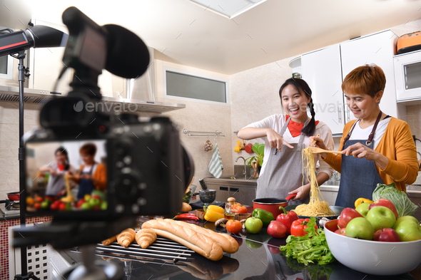 Mother and daughter cooking in the kitchen - Stock Photo - Images