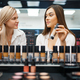 Cosmetician and woman choosing nail varnish - PhotoDune Item for Sale