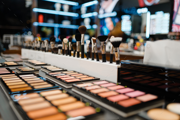 Showcase with powder and shadows, cosmetics store - Stock Photo - Images