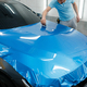 Car wrapping, man with squeegee installs film - PhotoDune Item for Sale