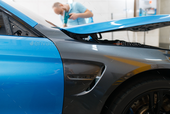 Car wrapping, protective foil or film coating - Stock Photo - Images