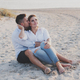 Young happy couple on the beach - PhotoDune Item for Sale