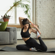 Sporty young muslim woman taking yoga lessons online and practice at home - PhotoDune Item for Sale