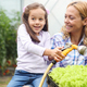 Beautiful happy mother and daughter working in the farm, garden - PhotoDune Item for Sale
