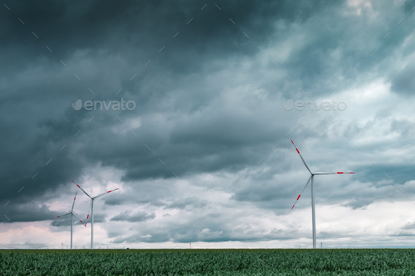 Green energy concept with wind turbines in field - Stock Photo - Images