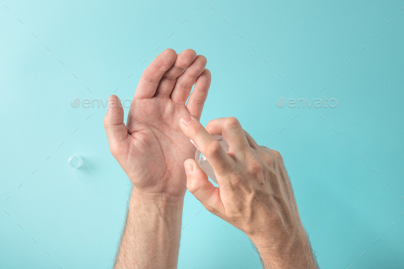 Hands spraying disinfecting antibacterial spray - Stock Photo - Images