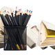 Colored pencils in a pencil pot and stacks of books. Isolate - PhotoDune Item for Sale