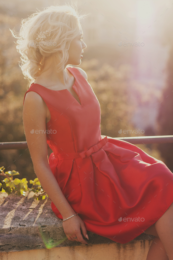 Amazing young woman in red dress - Stock Photo - Images
