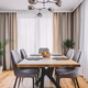 Dining room with wooden table and floor in modern apartment. - PhotoDune Item for Sale