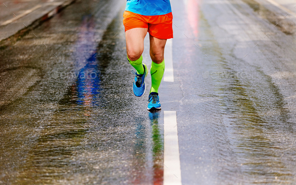 legs runner in compression socks - Stock Photo - Images