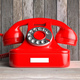Red vintage retro telephone on wooden table, wood wall background. 3d illustration - PhotoDune Item for Sale