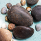 Black Pebble on the Blue Background - PhotoDune Item for Sale