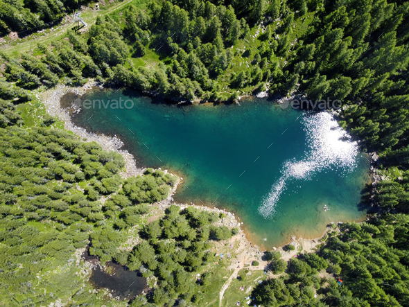 Aerial view of a blue mountain lake with forests - Stock Photo - Images