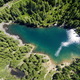 Aerial view of a blue mountain lake with forests - PhotoDune Item for Sale