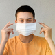 Teenage boy holding up a face mask - PhotoDune Item for Sale
