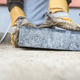 Building contractor laying a paving slab - PhotoDune Item for Sale