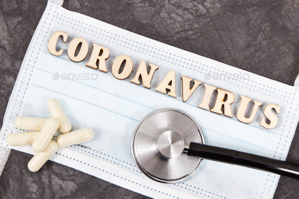 Inscription coronavirus with protective mask, tablets and stethoscope. Novel coronavirus. 2019-nCoV - Stock Photo - Images