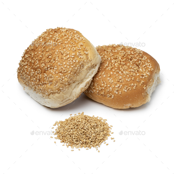 Fresh baked buns with sesame seed and a heap of sesame seed - Stock Photo - Images