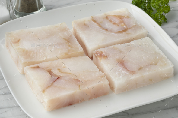 Dish with frozen cod fish fillets to thaw - Stock Photo - Images