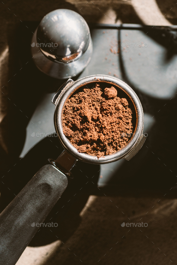 Ground coffee in portafilter - Stock Photo - Images