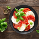 Caprese salad. Salad with mozzarella cheese, fresh tomatoes, basil leaves and olive oil - PhotoDune Item for Sale