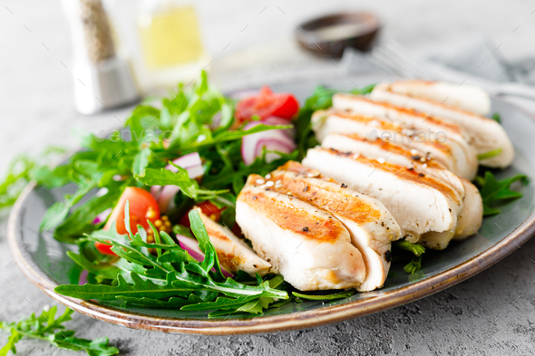 Chicken fillet salad with fresh vegetables and arugula - Stock Photo - Images