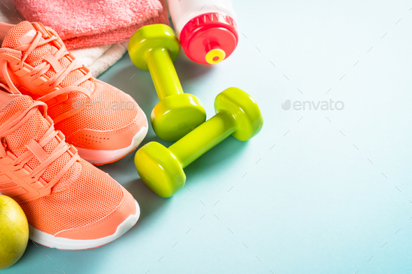Fitness equipment at blue background top view - Stock Photo - Images