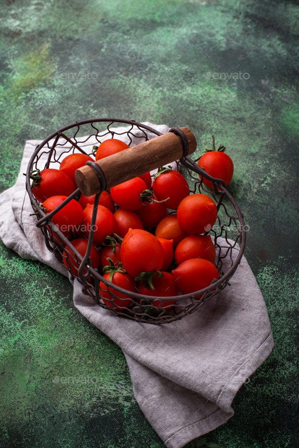 Cherry tomatoes on green background - Stock Photo - Images